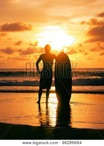 SIlhouette of a Surfer on the beach in Thailand