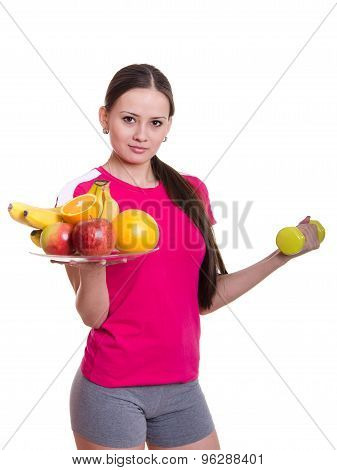 Beautiful Athlete Holding A Plate Of Fruit And Dumbbell