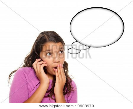 Shocked Hispanic Teen Aged Girl On Phone With Blank Thought Bubble