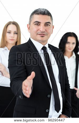 Adult Businessman Standing In Front Of His Colleagues