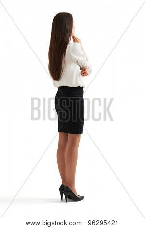 full-length portrait of pensive woman in formal wear. isolated on white background