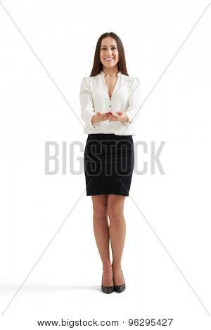 smiley businesswoman in formal wear holding open palms and looking at camera. isolated on white background