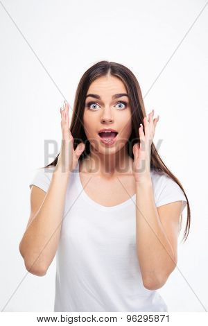 Portrait of a young amazed woman standing isolated on a white background. Looking at camera