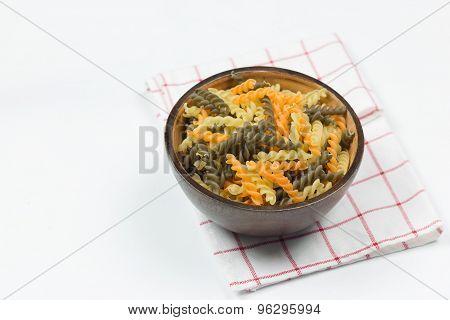 Uncooked Gluten Free Fusilli Pasta On Wood Blow