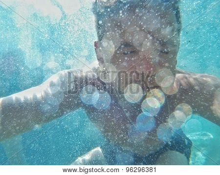 man swims into the water