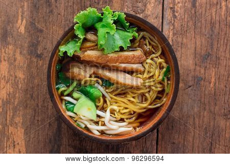 Yellow Noodle With Duck On Wood Bolw
