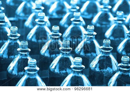 Rows of empty bottles in blue color tone