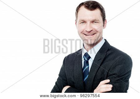 Smiling Businessman Posing Over White