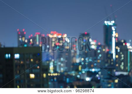 Blurred Photo bokeh of cityscape at night