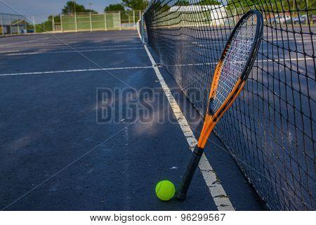 Tennis ball racquet and court