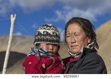 Old Local Woman With The Child In Ladakh. India