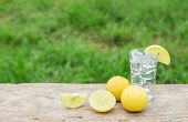 image of vodka  - Vodka with lemon on wooden table background  - JPG