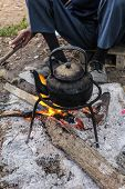 image of boiling water  - Old Kettle Boiling Water For Coffee Or Tea In Countryside In Thailand - JPG