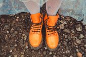 foto of woman boots  - Orange boots on the legs of a woman - JPG