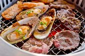 stock photo of braai  - Mixed Roasted Meat and Seafood on the BBQ Grill on roast - JPG