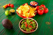 foto of nachos  - Mexican food nachos guacamole pico de gallo and chili peppers sauces - JPG