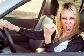 picture of pissed off  - Angry pissed off aggressive student girl driving car - JPG