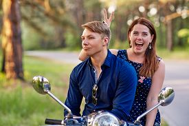 stock photo of prank  - Young woman is pranking his male friend - JPG