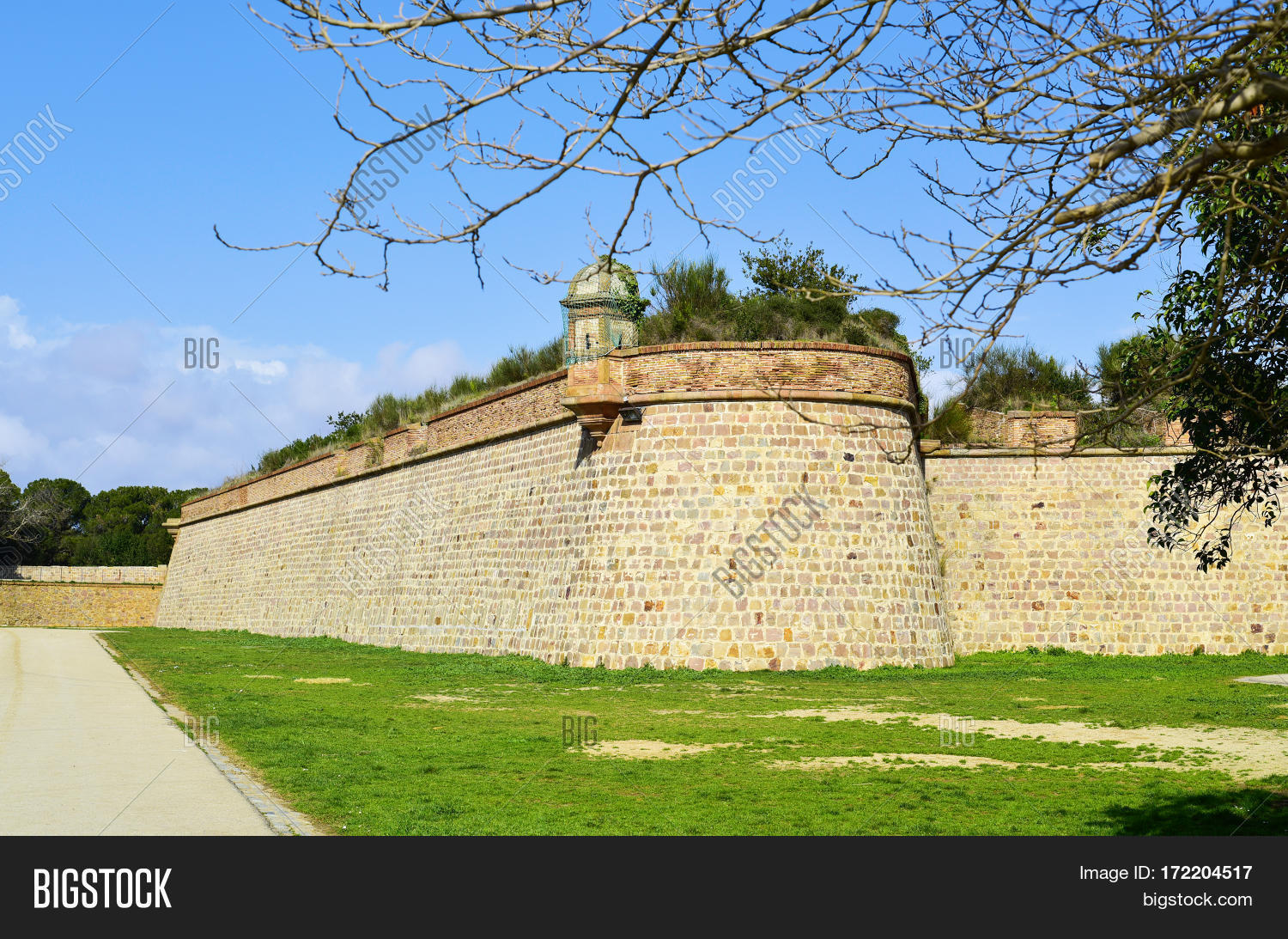 A Side View Of The Old Military Fortress Montjuic Castle In Barcelona, Spain
