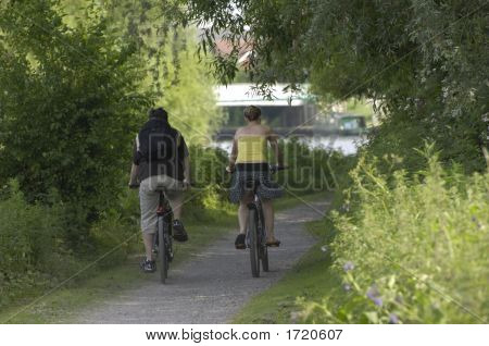 Boy And Girl Cycling