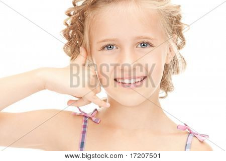 picture of little girl making a call me gesture