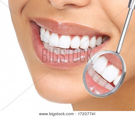 Healthy woman teeth and a dentist mouth mirror