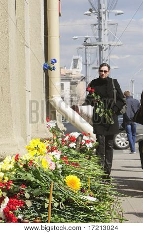 Woman Bringing Flowers to Oktyabrskaya Metro Station After Terrorist Attack on April 11, 2011 in Min