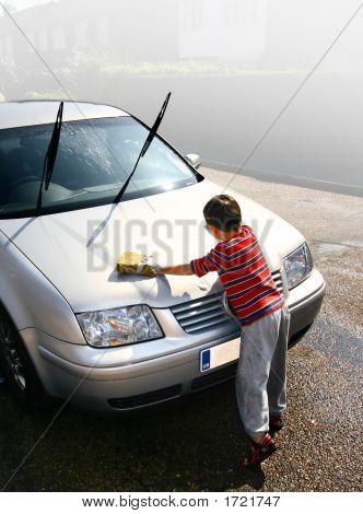 Young Boy Helps Washing The Car