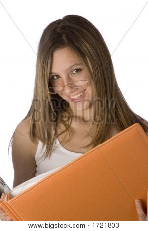 Teen Girl Reading Book With Glasses