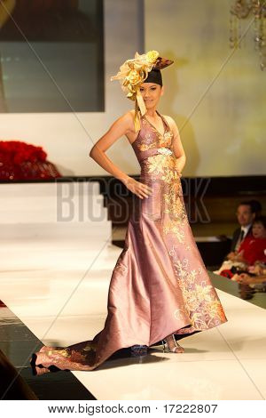 A model displays a dress by Dominique Chan