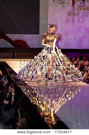 A model displays a glass slipper costume