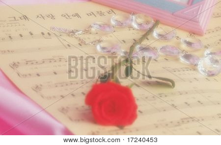 a red rose with musical notes