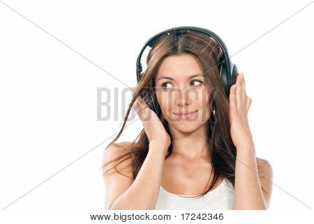 Slim Woman Listening And Enjoying Music In Headphones