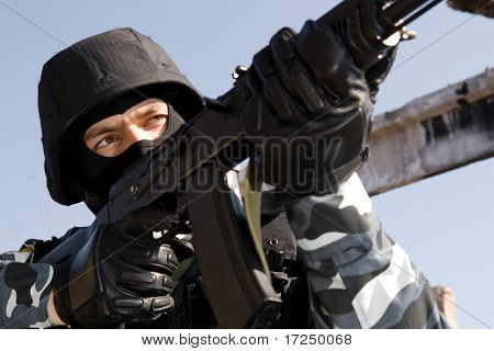 Portrait Of A Soldier Aiming With A Rifle