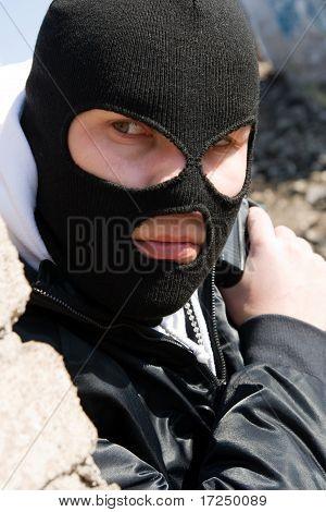 Burglar Waiting For His Victim