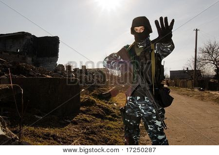 Soldier With A Gun Giving Stop Sign