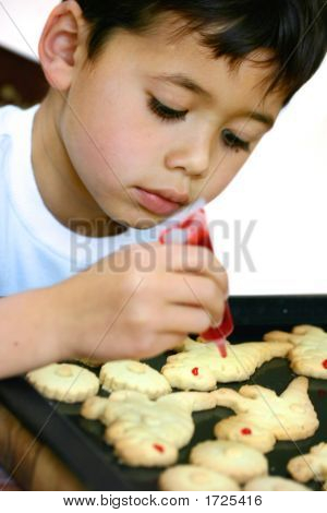 Boy Decorating Dinosaur Cookies