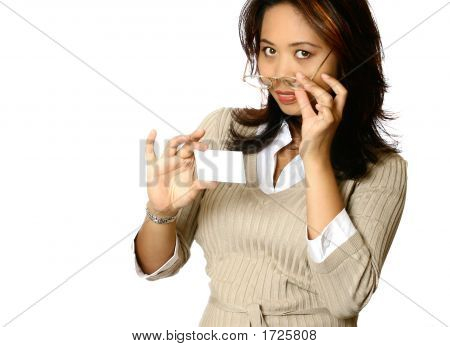 Businesswoman Removing Glasses While Holding Business Card