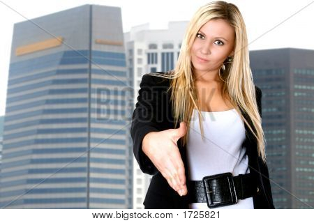 Blond Businesswoman Gesturing Handshake With Office Building Behind