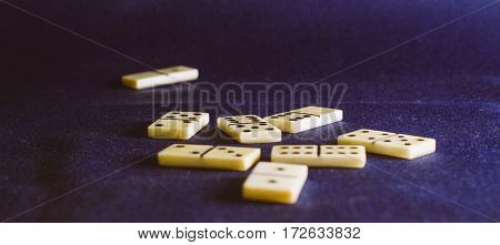 dominoes on the background of the fabric is very popular all over the world board game its purpose to the hands of the player there is not one dice