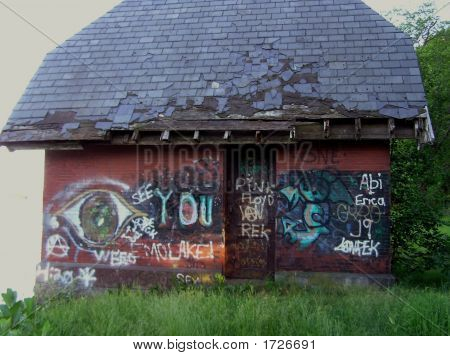 Bold Graffiti on Brick Building