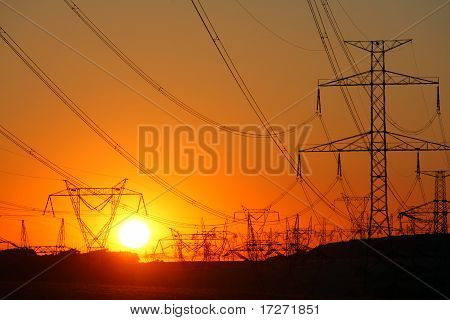 Transmission Towers At Orange Sunset