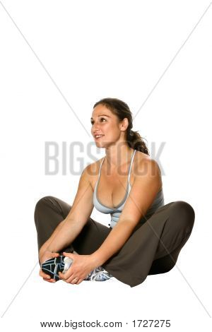 Woman Sitting In Sports Attire, Stretching