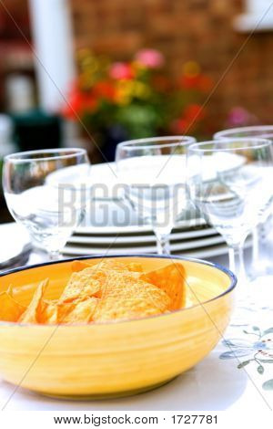 Table Setting For Outdoor Dining, Flowers In Background