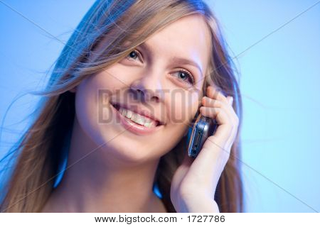 Smiling Beauty Talking On The Phone