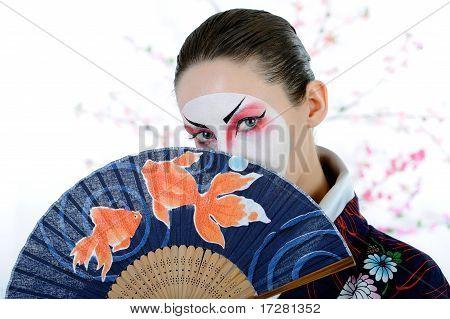 Japan Geisha Woman With Creative Make-up With Fan