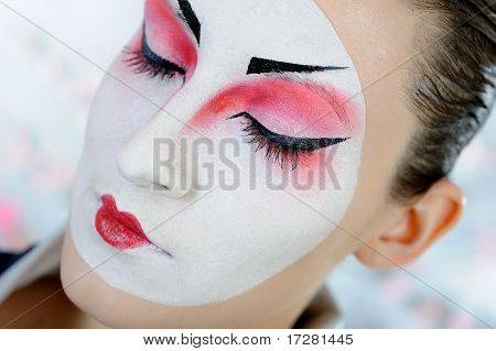 Close-up Artistic Portrait Of Japan Geisha Woman With Creative Make-up