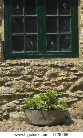 .Cottage Window With Planter