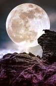 Super Moon Or Big Moon. Sky Background With Large Full Moon Behind Boulder. poster