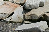 image of fieldstone-wall  - Broken down rocks and stones on a beach on Cornwall - JPG